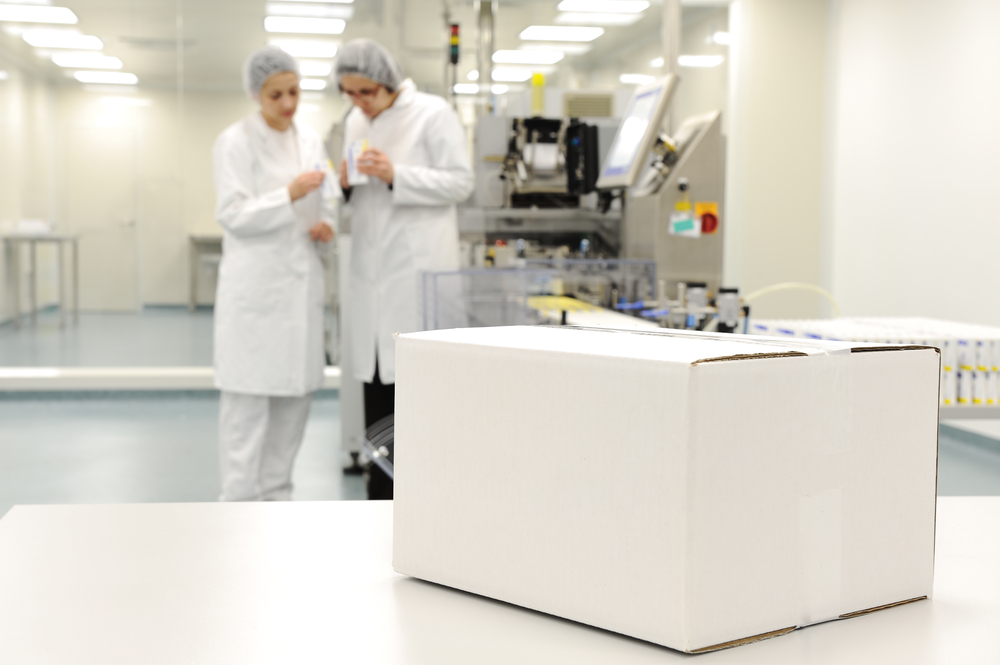White box at automated production line at modern factory - ready for your logo-1