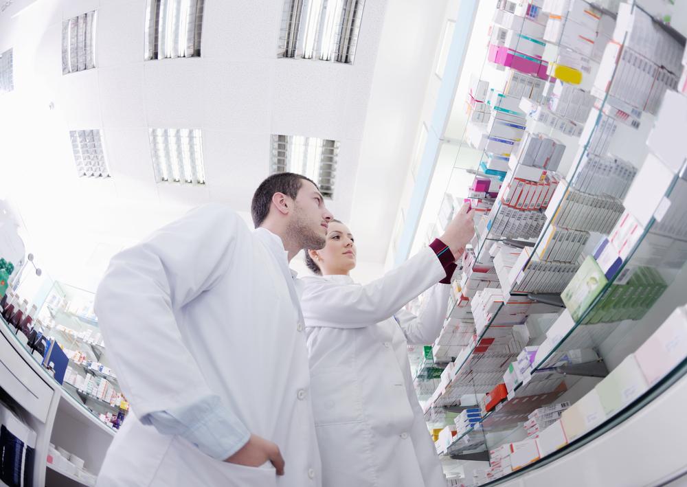 team of  pharmacist chemist woman and man  group  standing in pharmacy drugstore-1
