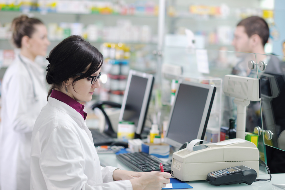 young pharmacist suggesting medical drug to buyer in pharmacy drugstore-3
